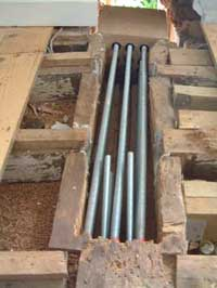Steel high tensile bars in a dugout structural beam