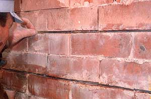Crack stitching in concrete, brick, stone and wood