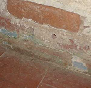 Quarry tile floor meets brick wall - needs 'tanking' below the damp proof course