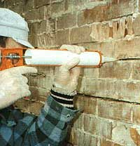 Injecting Thixor rapid into wall cracks